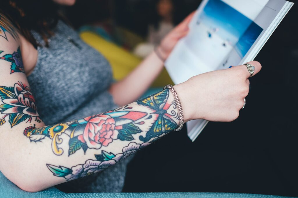 A person with a tattooed arm