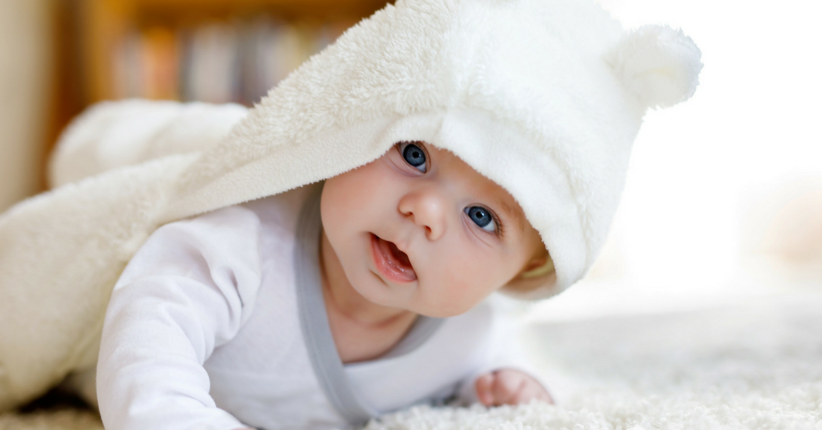 adorable baby with blanket on head